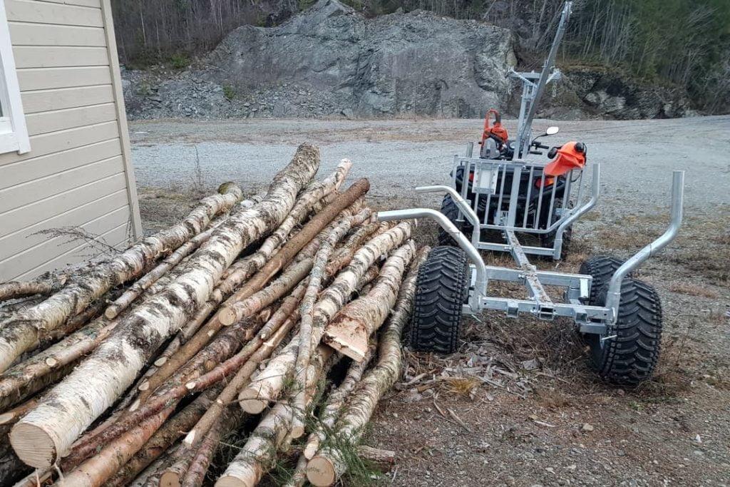 unloading firewood atv logging trailer